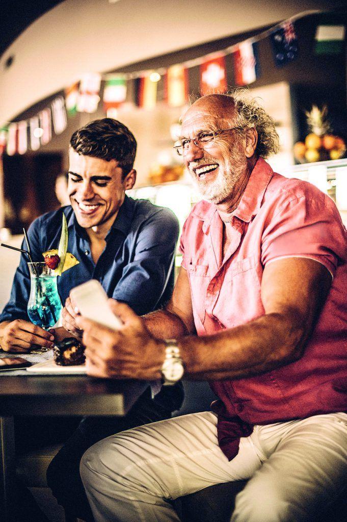 Father and son having fun in pattisserie