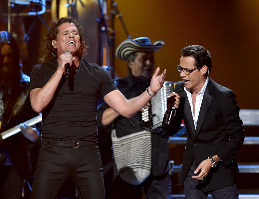 LAS VEGAS, NV - NOVEMBER 20:  Recording artists Carlos Vives (L) and Marc Anthony perform onstage during the 15th annual Latin GRAMMY Awards at the MGM Grand Garden Arena on November 20, 2014 in Las Vegas, Nevada.  (Photo by Kevin Winter/WireImage)