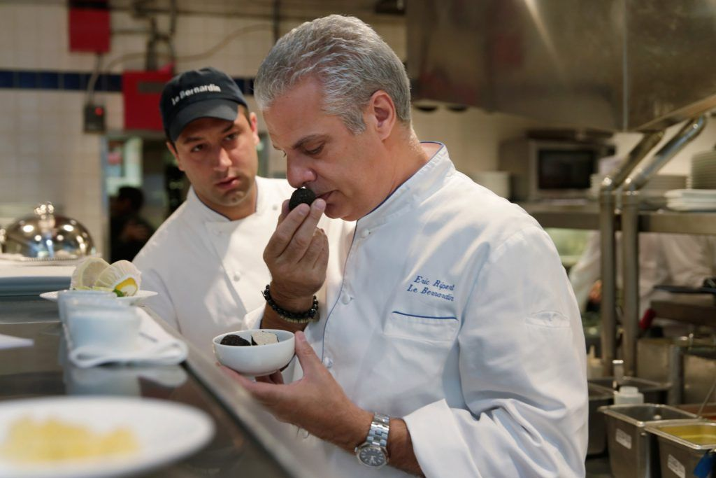 Chef Eric Ripert, sniffs the truffles in the kitchen of his restaurant, Le Bernadin, before the lunch service, in New York, Tuesday, May 17, 2016.  Ripert recalls an uphill climb to culinary greatness in an engrossing new memoir, ì32 Yolks.î (AP Photo/Richard Drew)