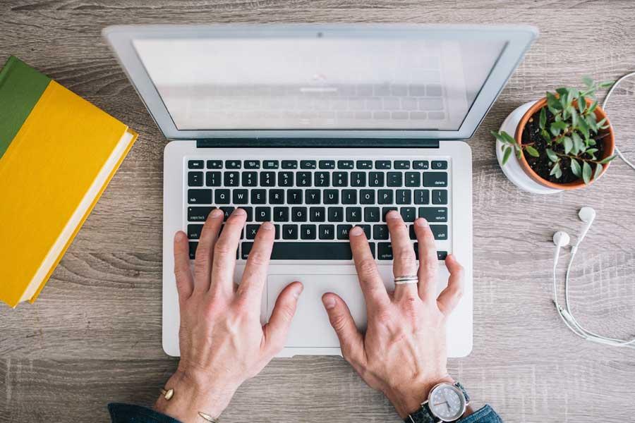 typing-on-laptop-deathtostock