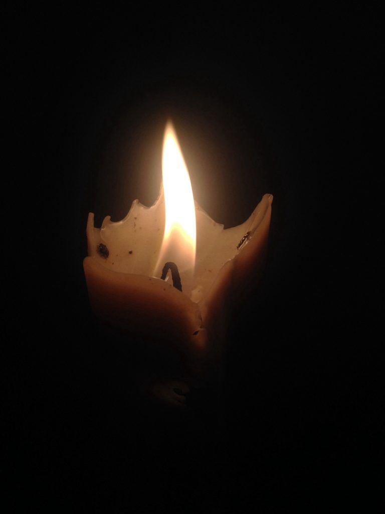 Candle glowing in the dark